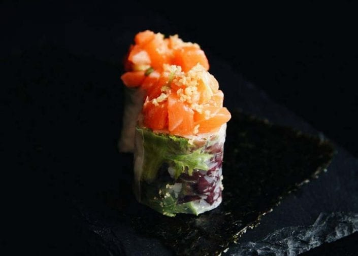 Blossom truffle salmon sushis on a plate